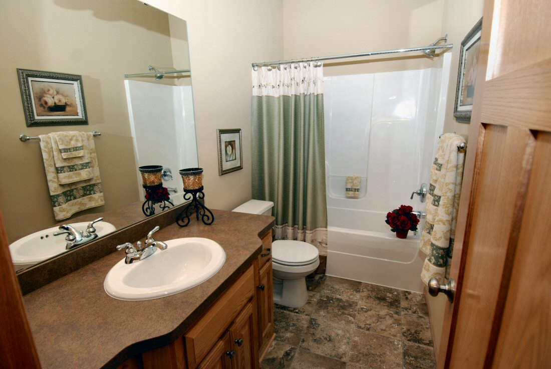 New single family homes and custom remodeling by woodcrest for Main bathroom design ideas